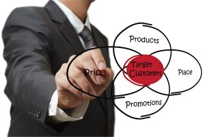 businessman hand draws target customers diagram on white board