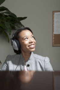 black business-woman-listening-to-music