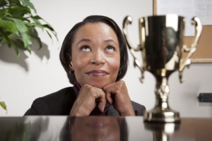 black business-woman-with-award-dreaming-min
