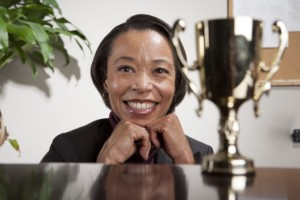 black business-woman-with-award-min