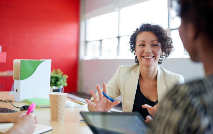 A happy woman receiving small business coaching