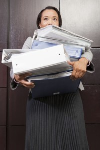 business-woman-carrying-files