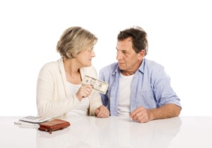 Senior Couple with Wallet & Money