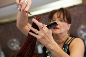 woman giving haircut - best hair salons