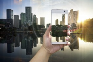 iPhone superimposed on city - advertising business